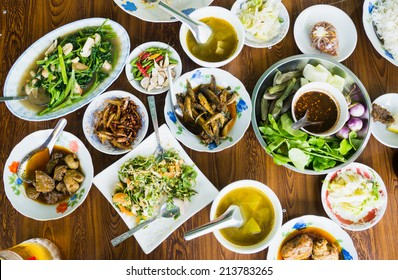 A table with assorted food at a restaurant in Myanmar.