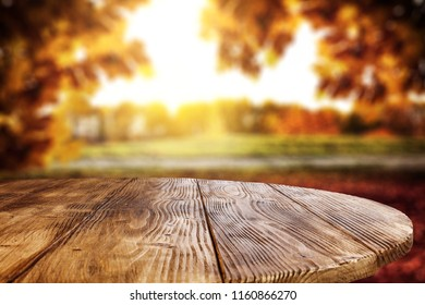 table background brown table background and autumn landscape free space for your decoration background autumn landscape space stock photo edit now