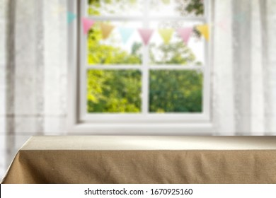 table background cover of tableclothe and blurred space and spring window.Copy space for your products.