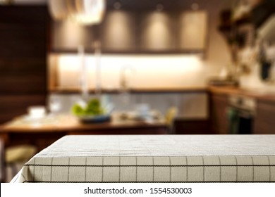 Table background of free space and blurred home interior. Copy space.