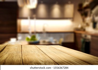 Table background of free space and blurred home interior with fireplace.