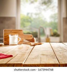 Table background of free space and blurred background of kitchen