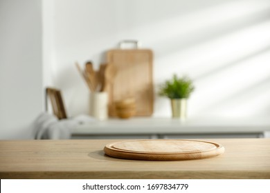 Table background of free space and kitchen interior.White wall with shadows and sunny warm morning time.Copy space for your composition.  - Shutterstock ID 1697834779