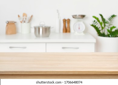 Table background of free space on blurred kitchen counter interior