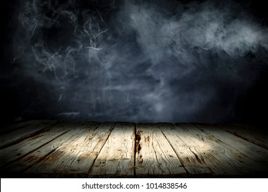 Table background of free space for your decoration and dark background of shadows and smoke. Desk place for your product or text.
