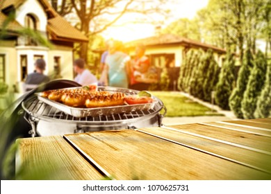 Table background of free space for your product and grill in garden. Spring time background space.