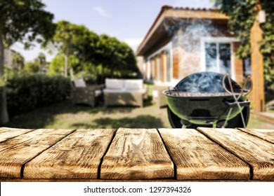 Table background of free space for your decoration. Grill with smoke. Garden place of spring time.