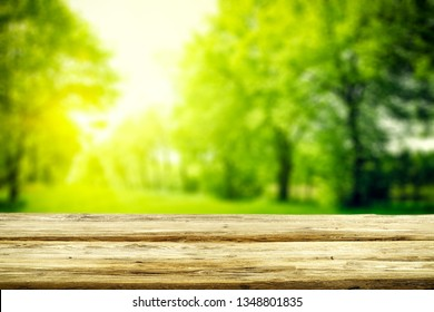 Table background of free space for your decoration and spring blurred background.