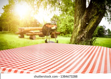 Table background of free space for your decoration and grill time in garden. Summer sunny day.