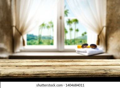 Table background of free space for your decoration and summer window. Landscape of natural palms.