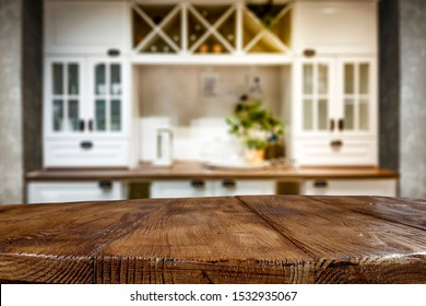 Table background of free space for your decoration and blurred furniture of kitchen. Chritmas time in home.