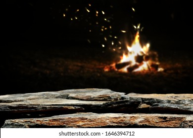 Table background of free space for your decoration and dark mood photo of campfire.Copy space and dark night time.
