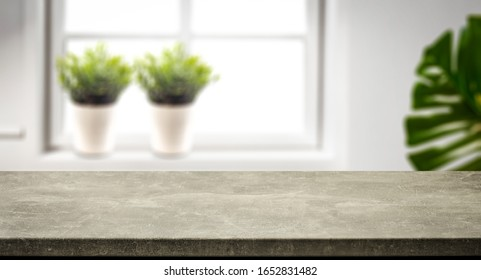 Table background of free space for your decoration and whte home interior with big window.Spring time and sunny day.