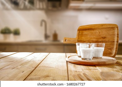 Table background of free space for your decoration and blurred window in kitchen interior.