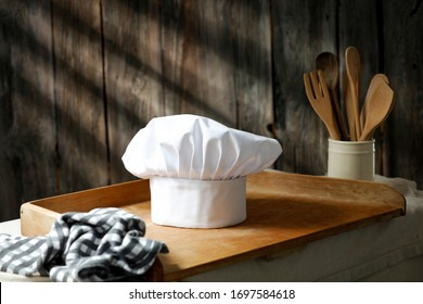 Table background of free space for your decoration and kitchen interior.Retro old worn wooden wall and dark shadows of sun light.
