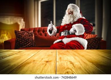 santa claus on red sofa home stock photo edit now 742834612 rh shutterstock com Santa Claus Designs Living Room Christmas Holiday