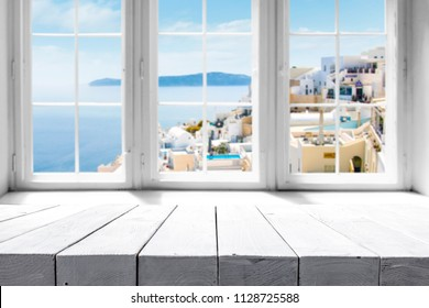 Table background and window space with summer landscape of Greece
