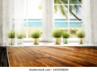 Table background wooden top and white window view with beautiful ocean in distance