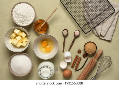 Table with baking ingredients. Plaster beige background. View from above