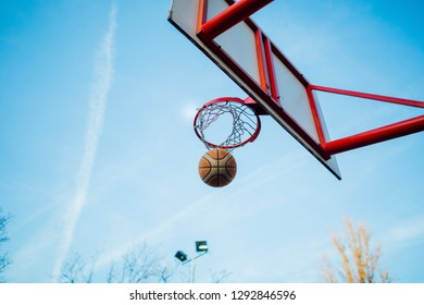 Table, basket and basketball hoope above the sky