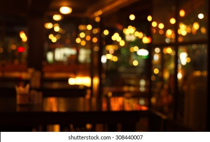table in blur pub or bar nightclub and restaurant at Christmas night celebrate party with bokeh light background
