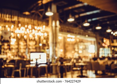 table in blur pub or bar and restaurant at night party with bokeh light background