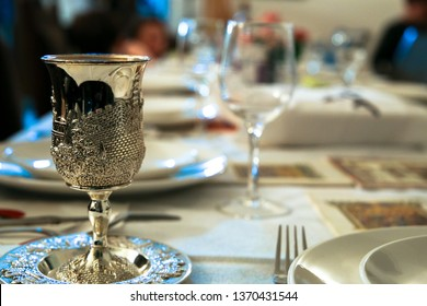 table bound for a traditional Passover seder with a cup of Elijah the Prophet