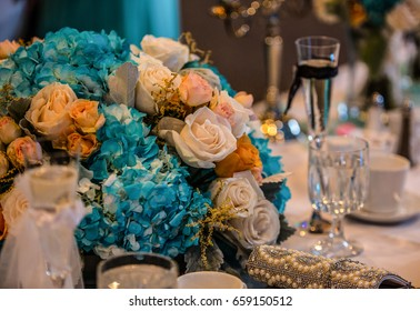 Table bouquet with glasses and coffee cup