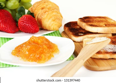 Table Breakfast - Continental Breakfast, fruit, jam, and toast.