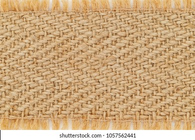 Table burlap Runner with fringe, copy space.  Brown burlap hemp texture background, close up