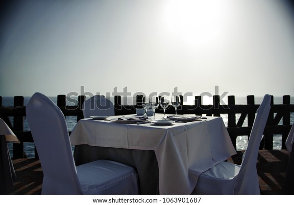 A table in a cafe in the evening on the ocean shore