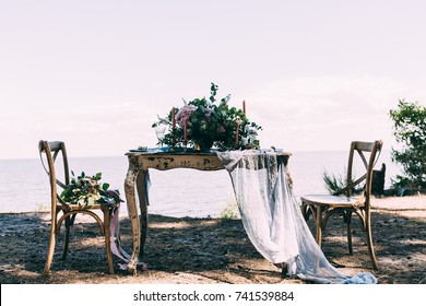 a table with candles and a wedding bouquet
