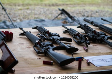 A table with carbine rifles