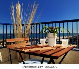 Table and chair in balcony near the beach