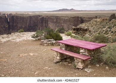 table and chair fot rest near a canyon