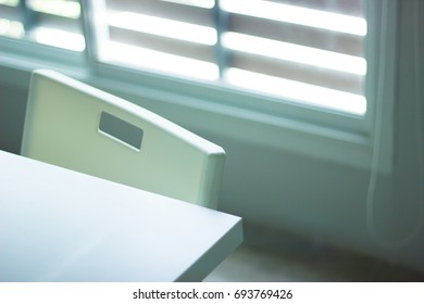 Table and chair near window