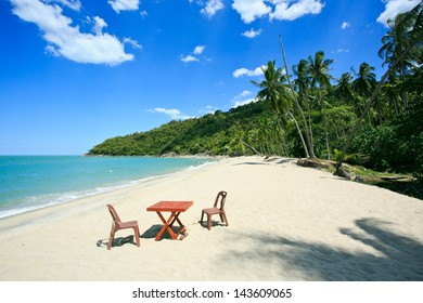 Table and chair on the beach