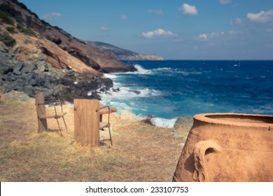 Table and chair at a remote rural beach on a sunny day.vintage editing