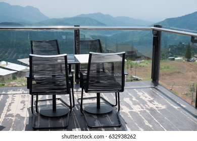 Table and chair set on mountain background