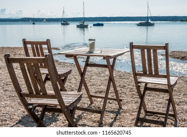 table and chairs at the ammersee lake in bavaria
