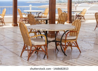Table and chairs in beach cafe next to the red sea in Sharm el Sheikh, Egypt, close up