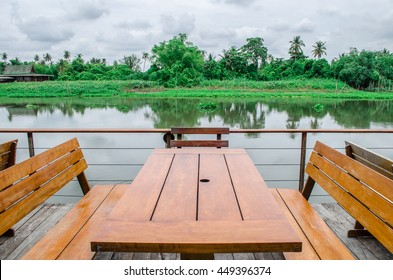 Table and chairs beside the beautiful river
