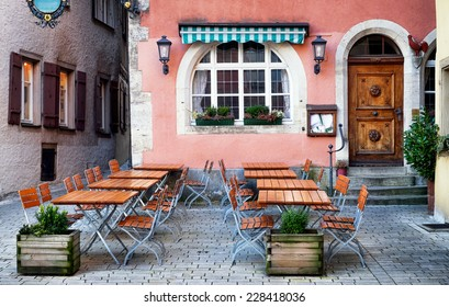 table and chairs at a cafe - beergarden