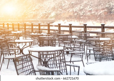 Table And Chairs Covered In Winter Snow