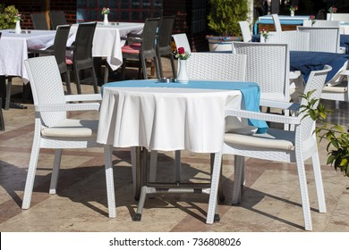Table and chairs in empty cafe near the beach.