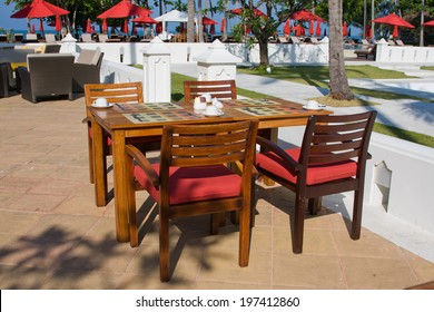 Table and chairs in empty cafe. Thailand.