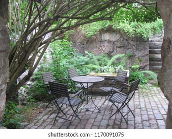 Table and chairs in the inner garden, vintage