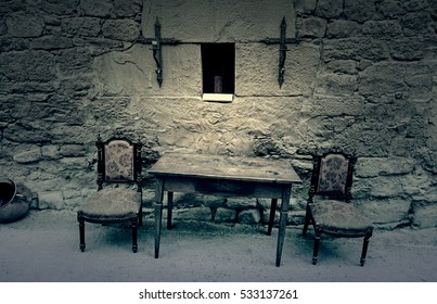 Table and chairs of the Inquisition, detail of a scene from the old Spanish Inquisition, religicion and furniture