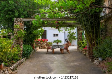 Table and chairs in a mediterranean garden