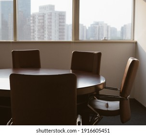 table and chairs in a meeting room with window in Beijing's international financial center